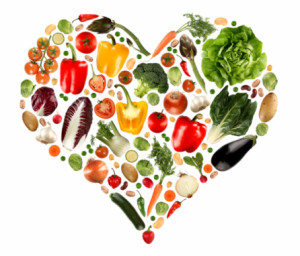 An assortment of vegetables placed together to make up the shape of a heart.